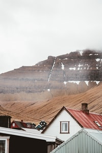 houses with brown mountain in vicinity