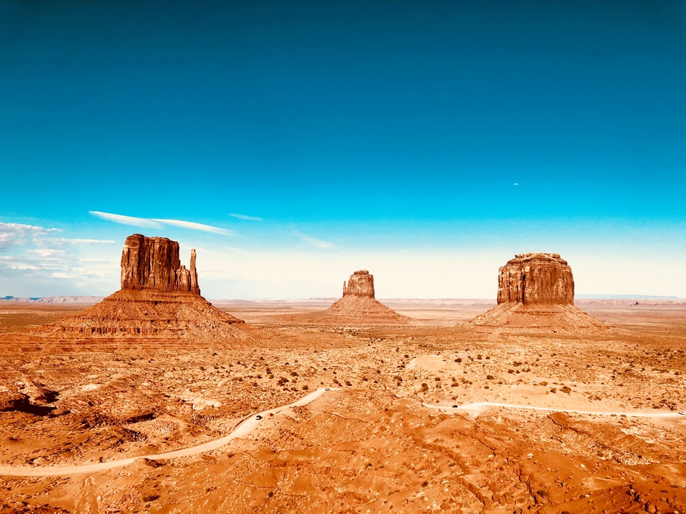 landscape photo of three brown rock formations