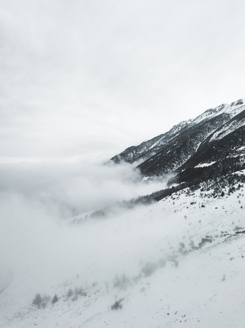 snow capped mountain under cloudy sky at daytime