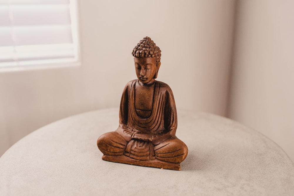 Gautama figurine on table
