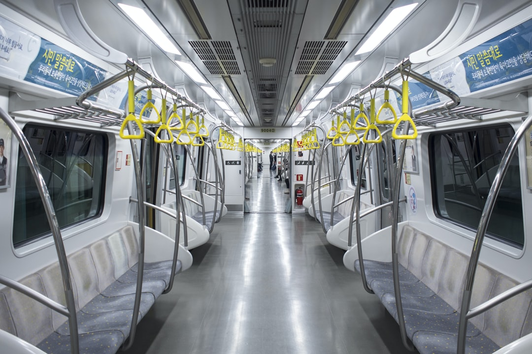 An almost empty train in the afternoon in Seoul, Korea. I was drawn by the contrast between the vibrant yellow handles and the bright, clean train.