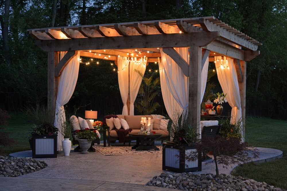 photo of gazebo with curtain and string lights