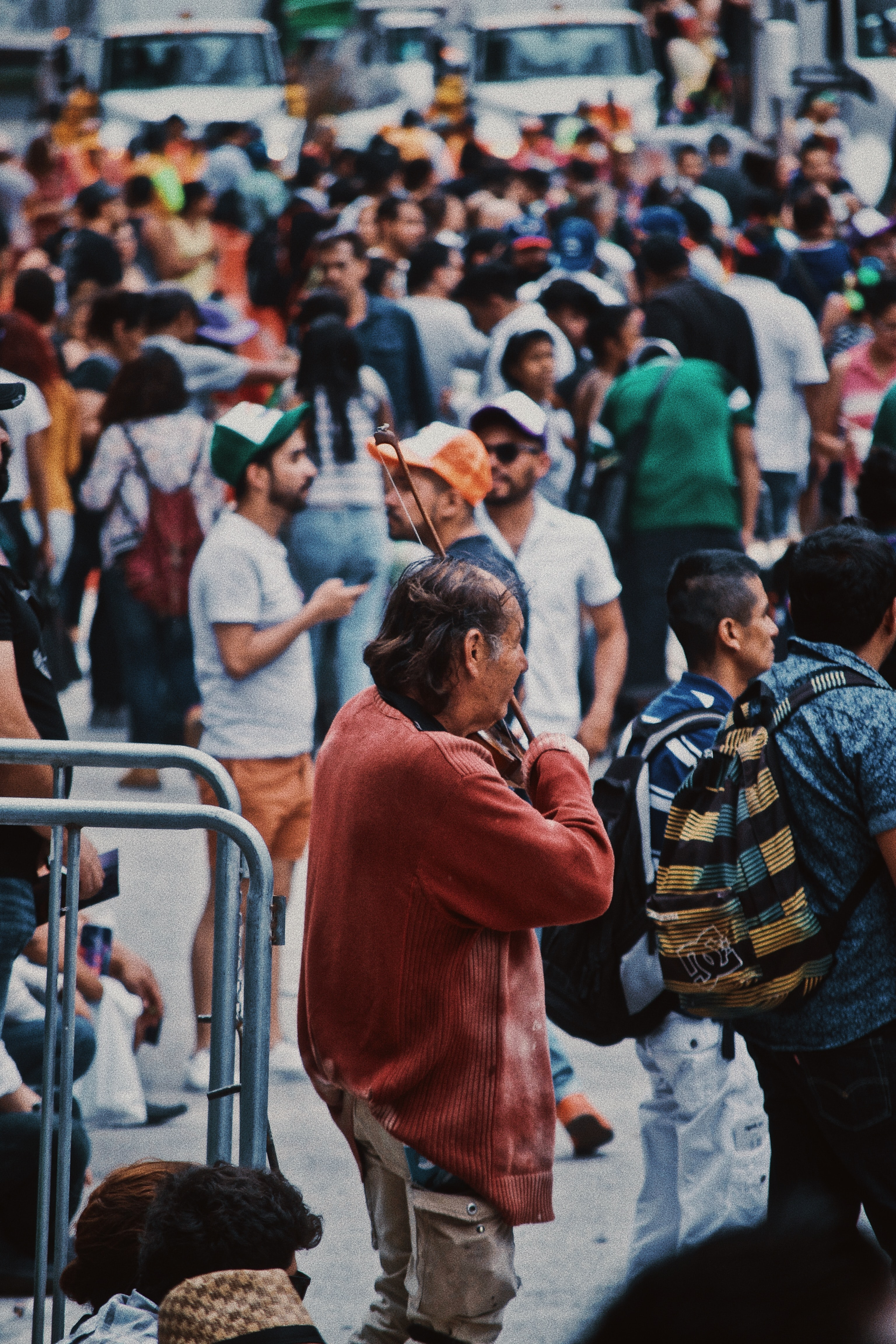 man playing violin in a crowded place