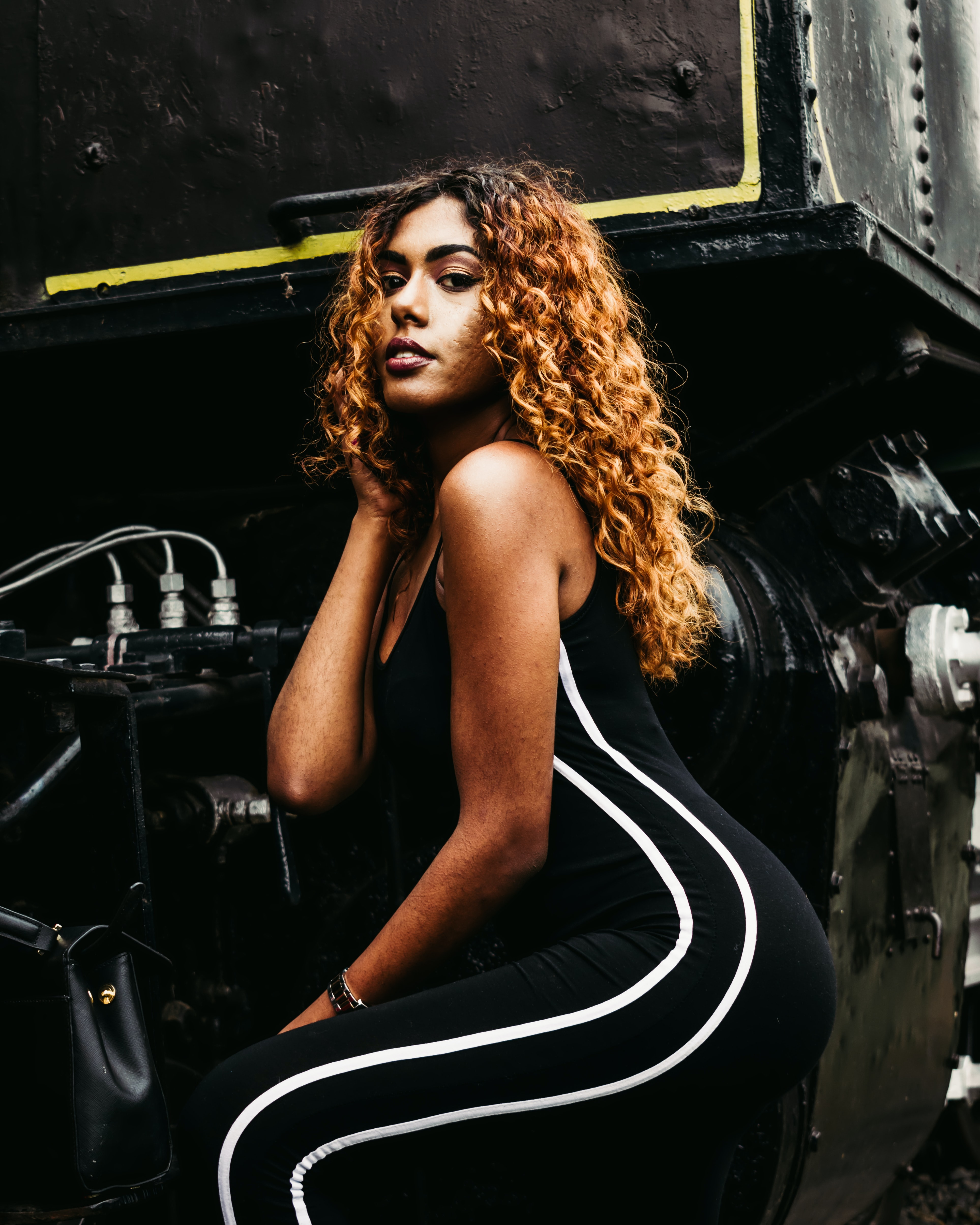 woman sitting beside engine