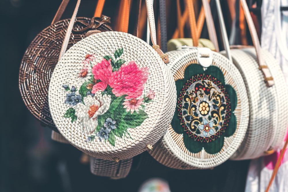 photo of assorted-color-and-pattern wicker bags