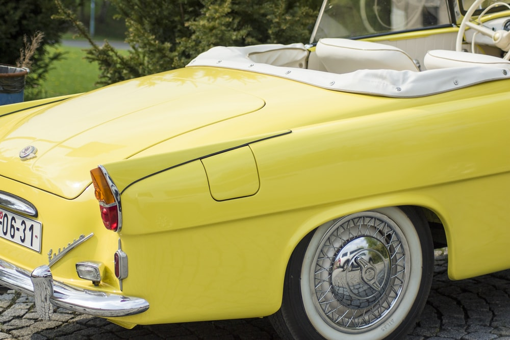parked yellow convertible