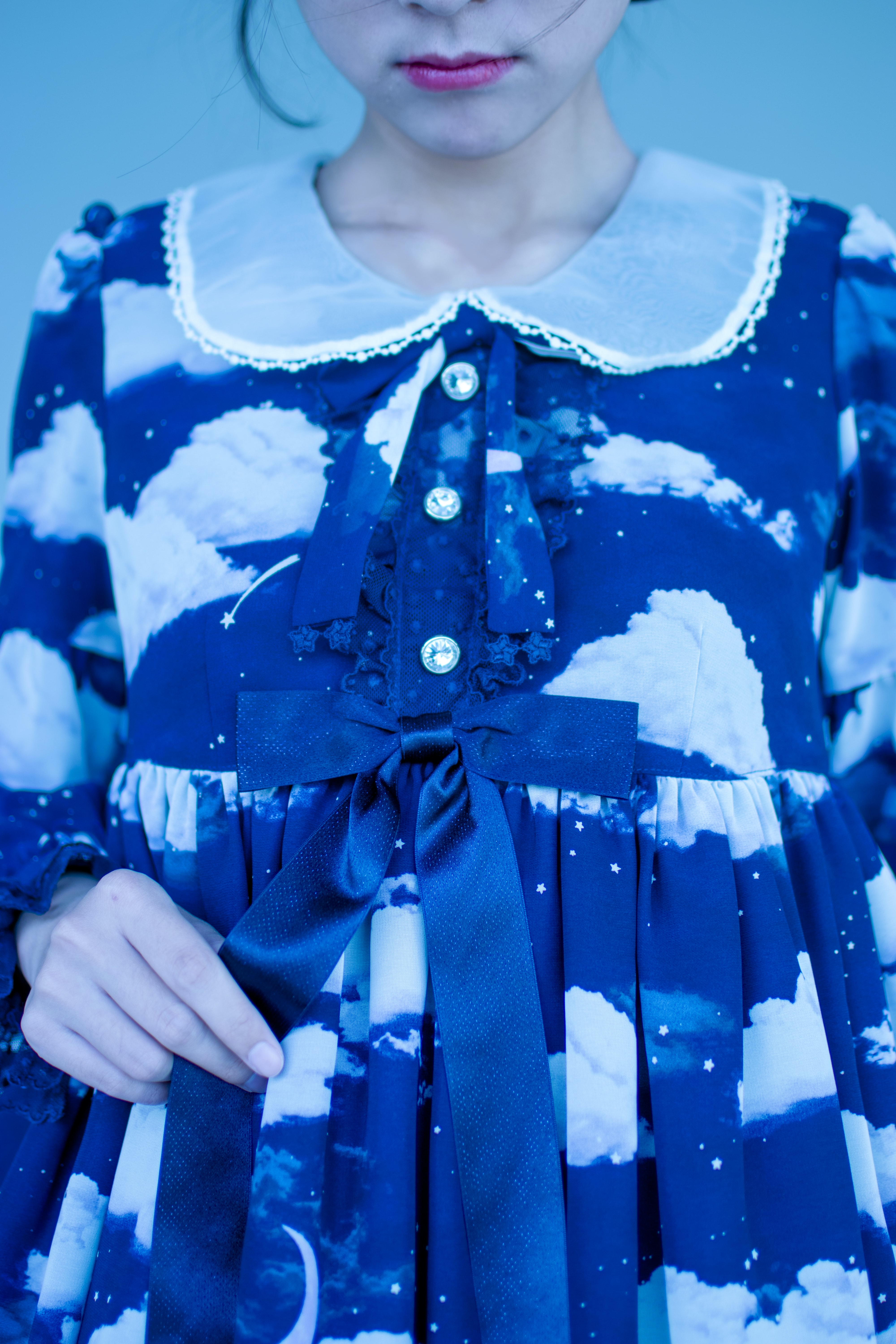 closeup photo of woman in blue and white collared long-sleeved dress