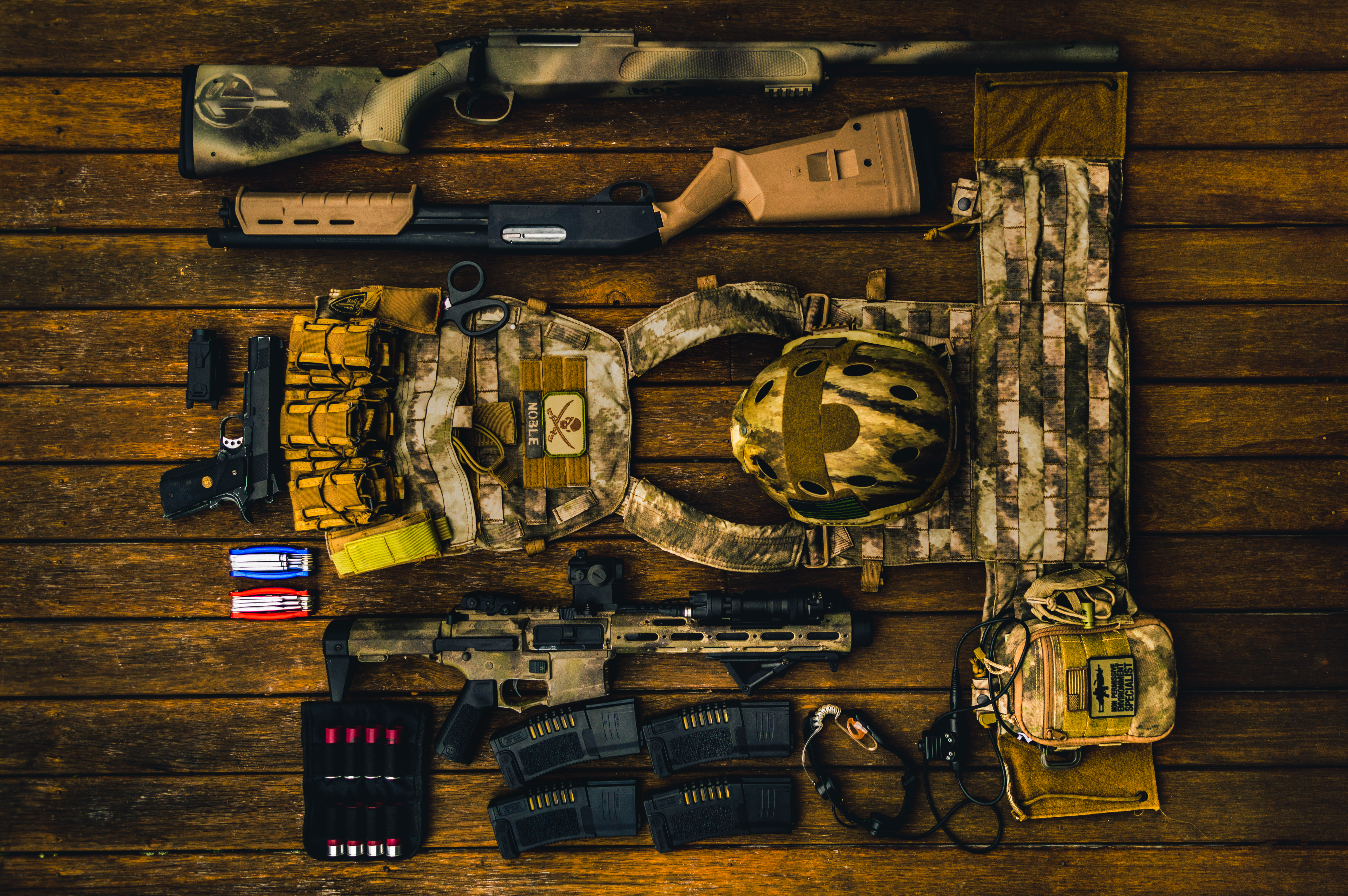 Brown And Beige Army Gear Set On Brown Surface