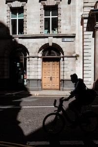 man riding bicycle near building at daytime