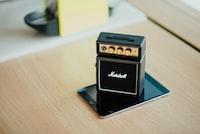 black Marshal guitar amplifier on speaker on smartphone