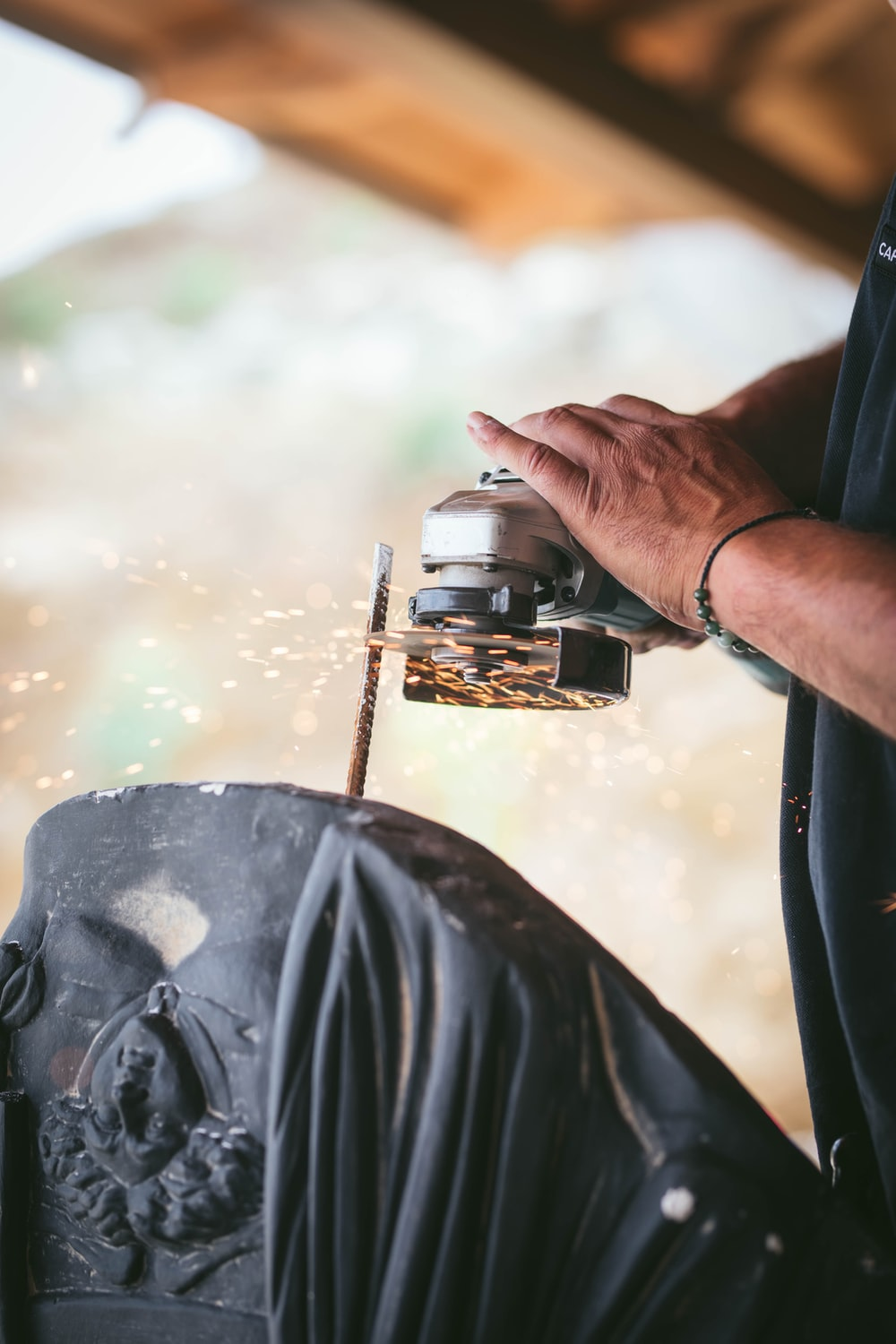 person using gray angle grinder