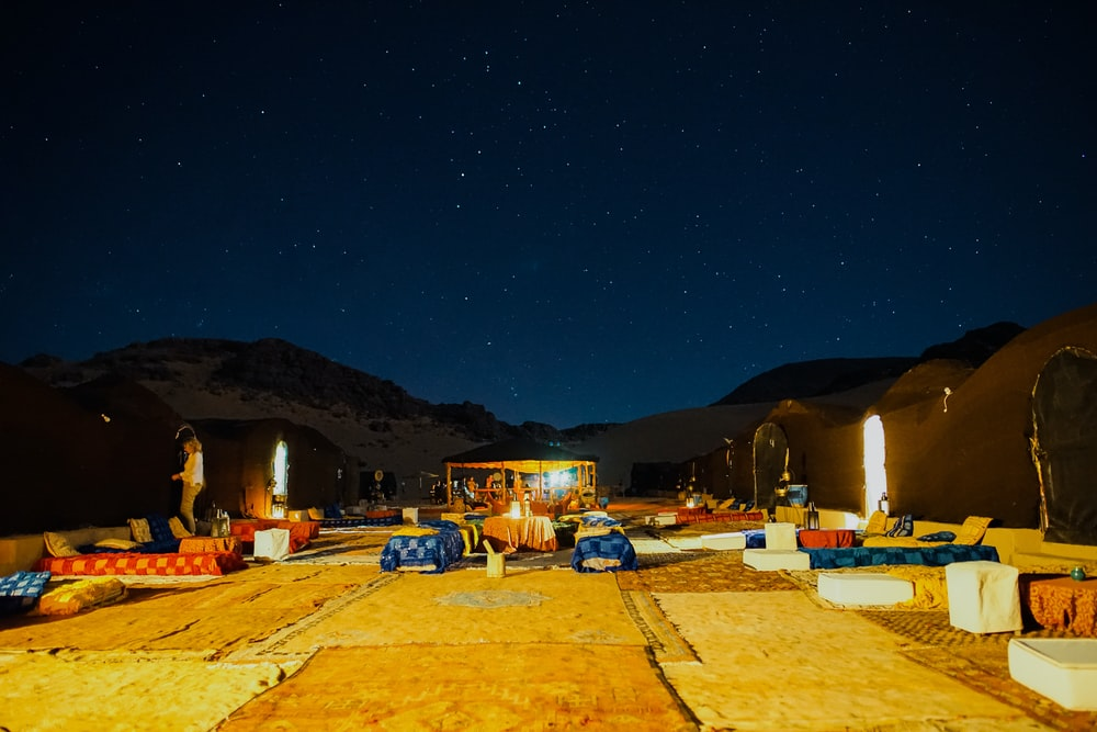 lined up outdoor beds under starry night