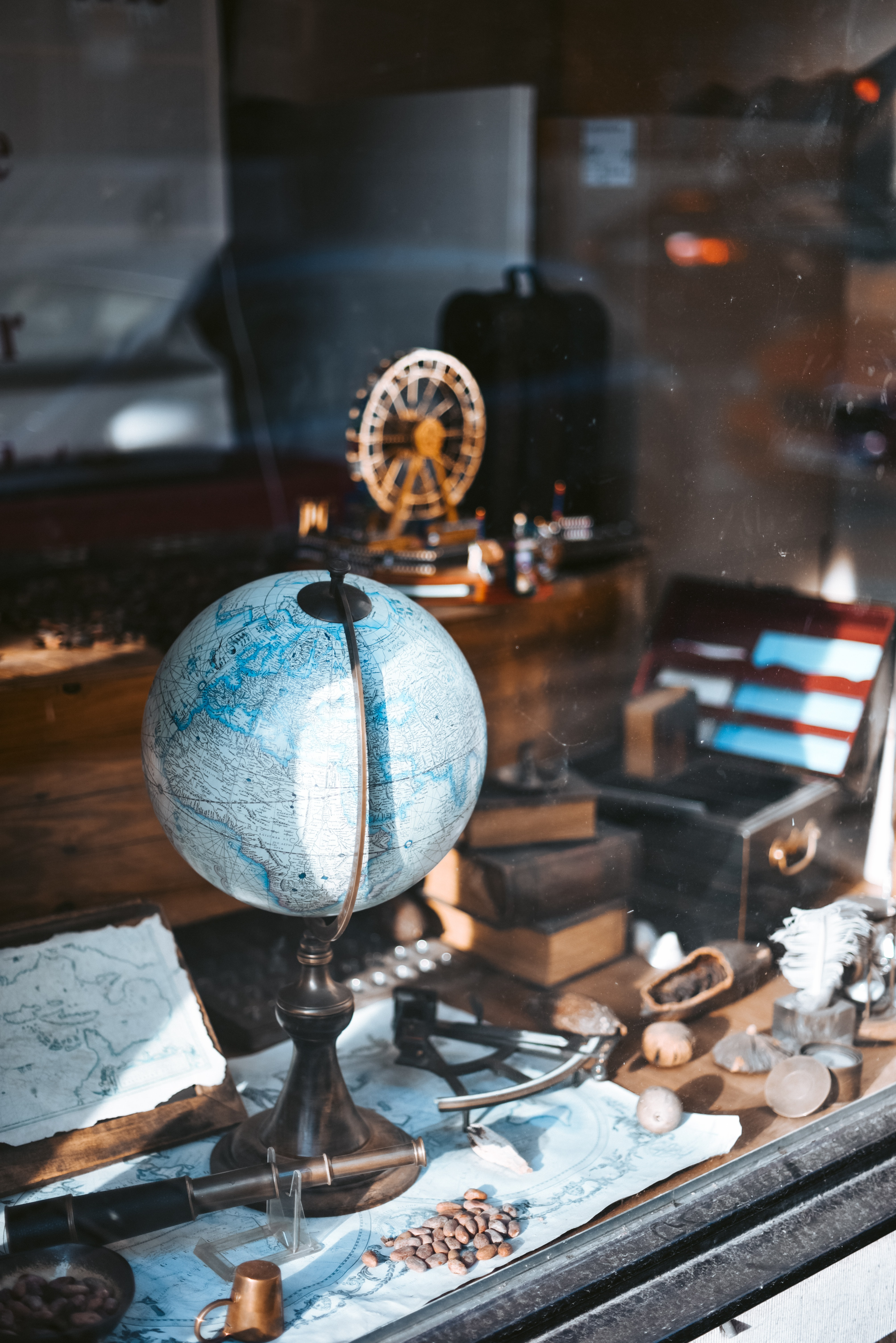 blue globe map on table