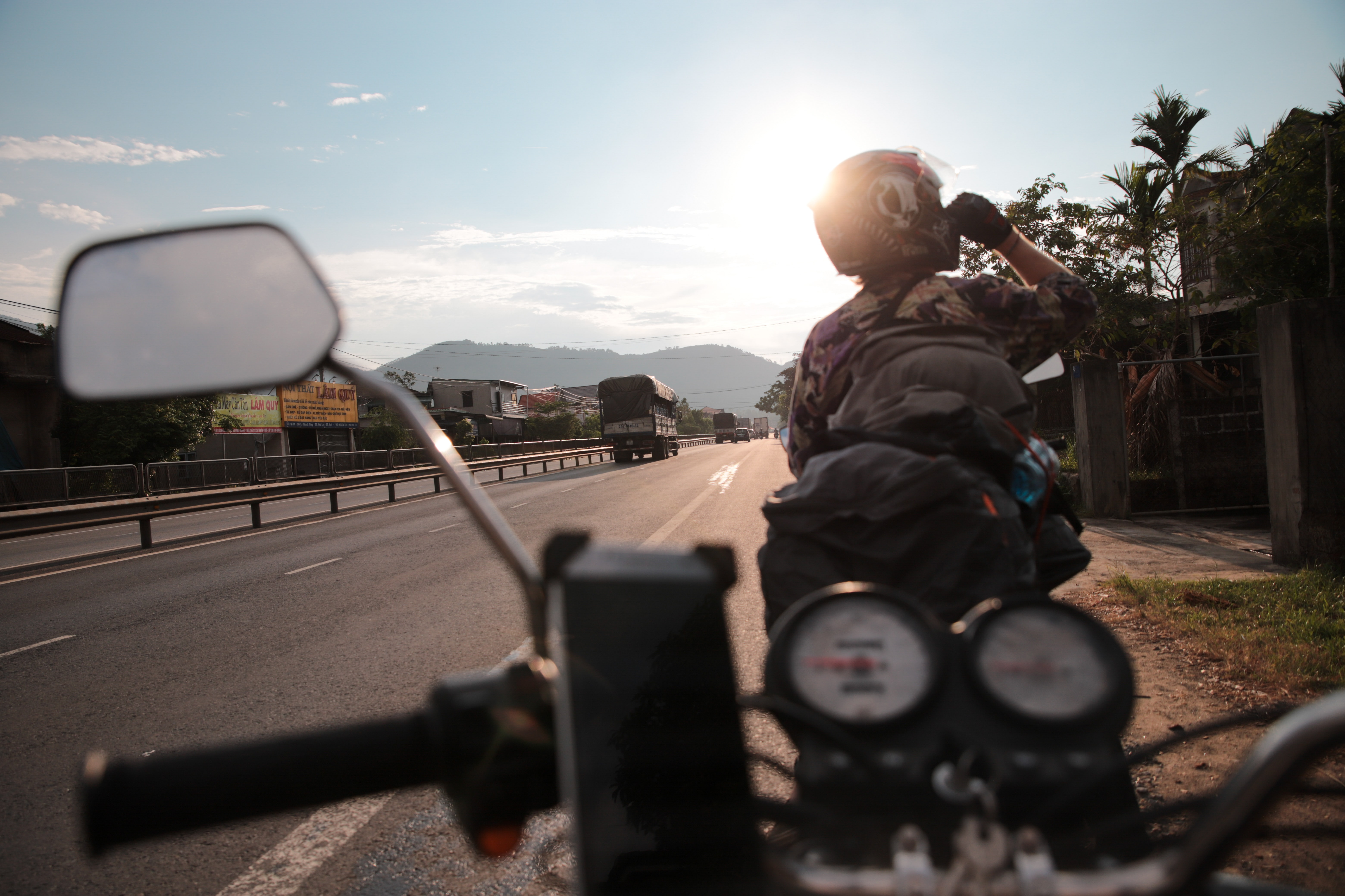 man driving motorcycle on road