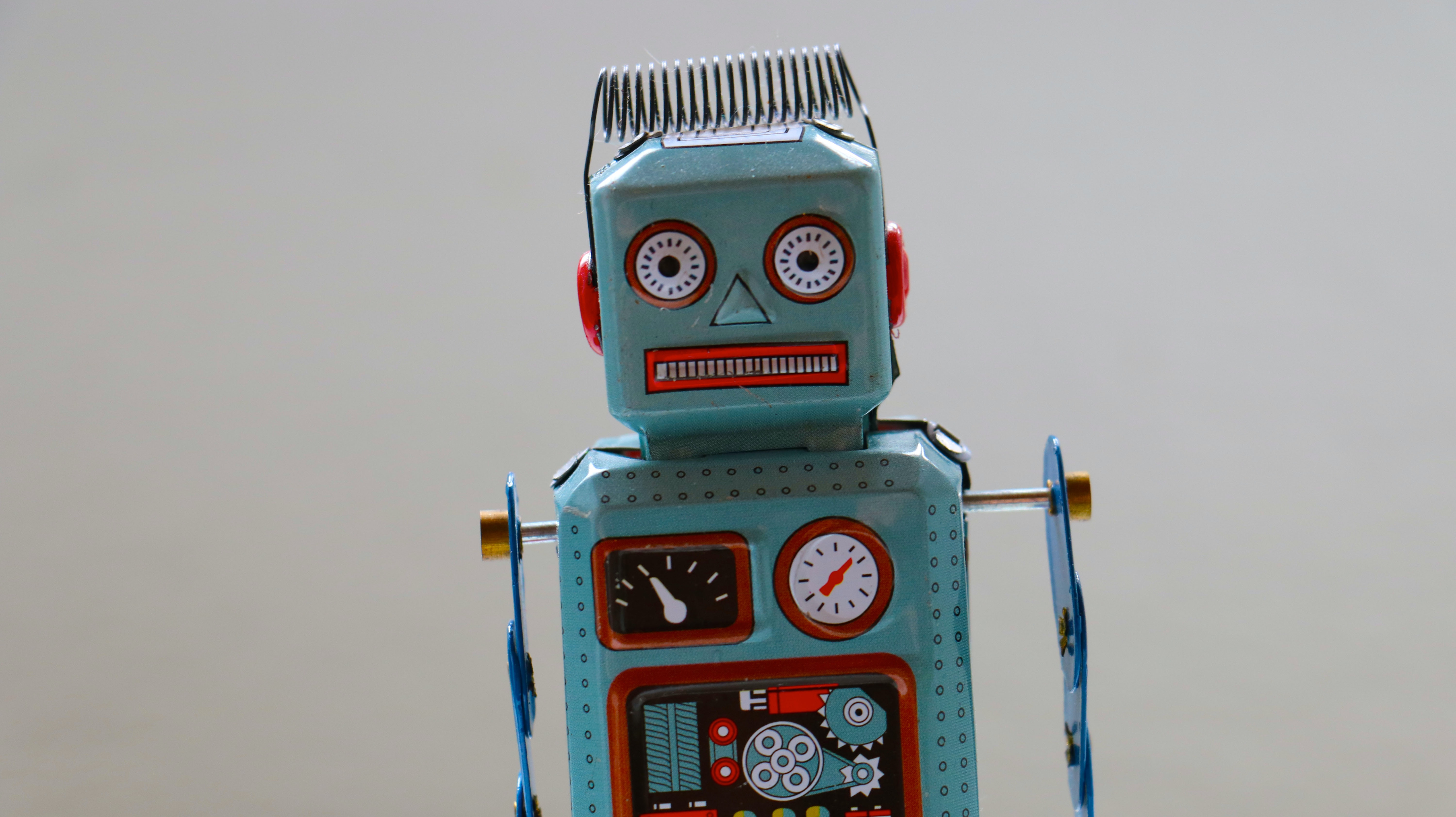 An old looking mechanical robot looking at you