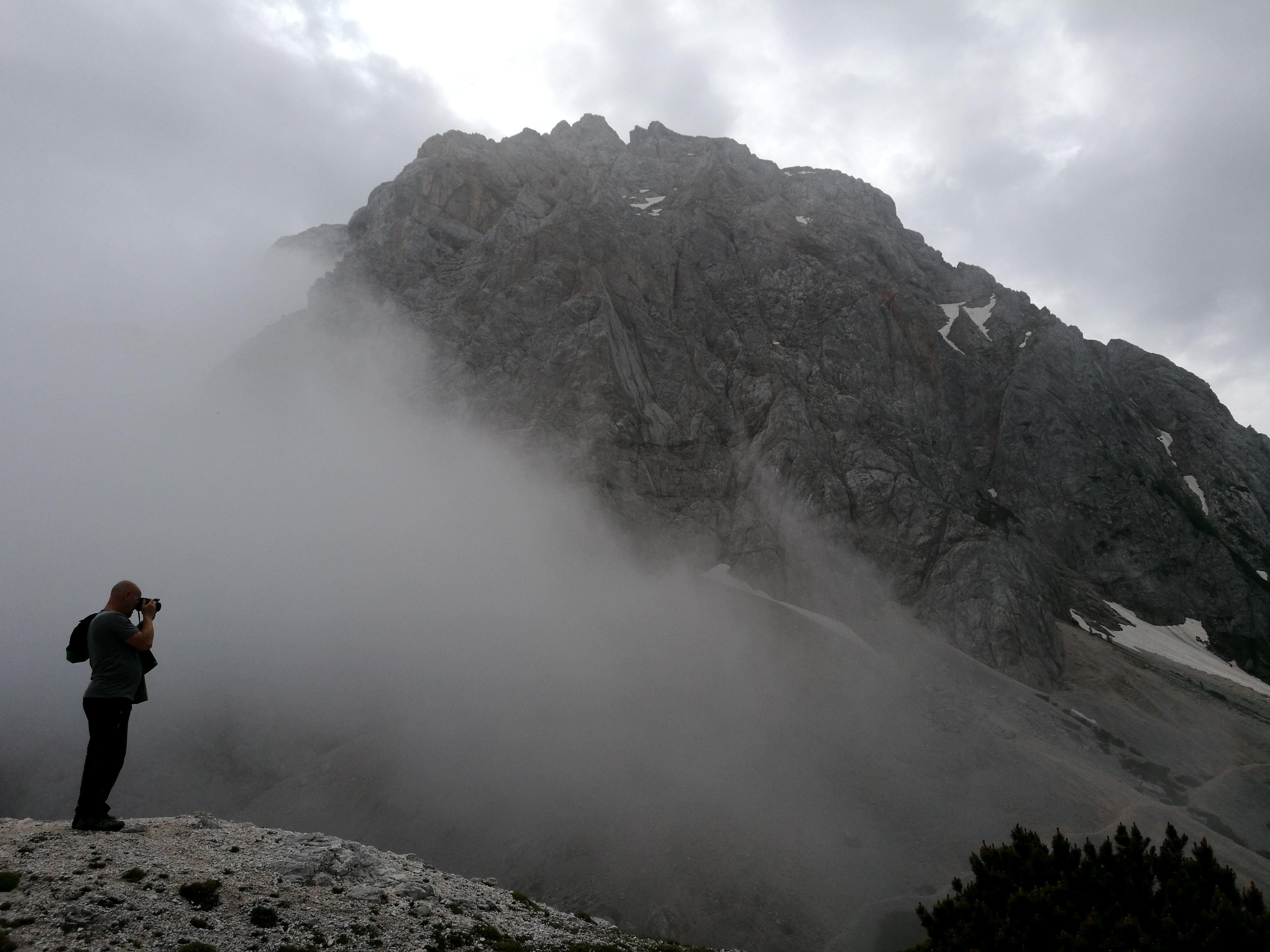 man taking photo at mountain during daytyime