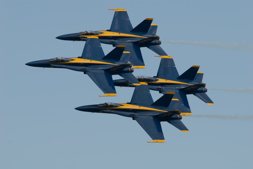 four blue jet fighters