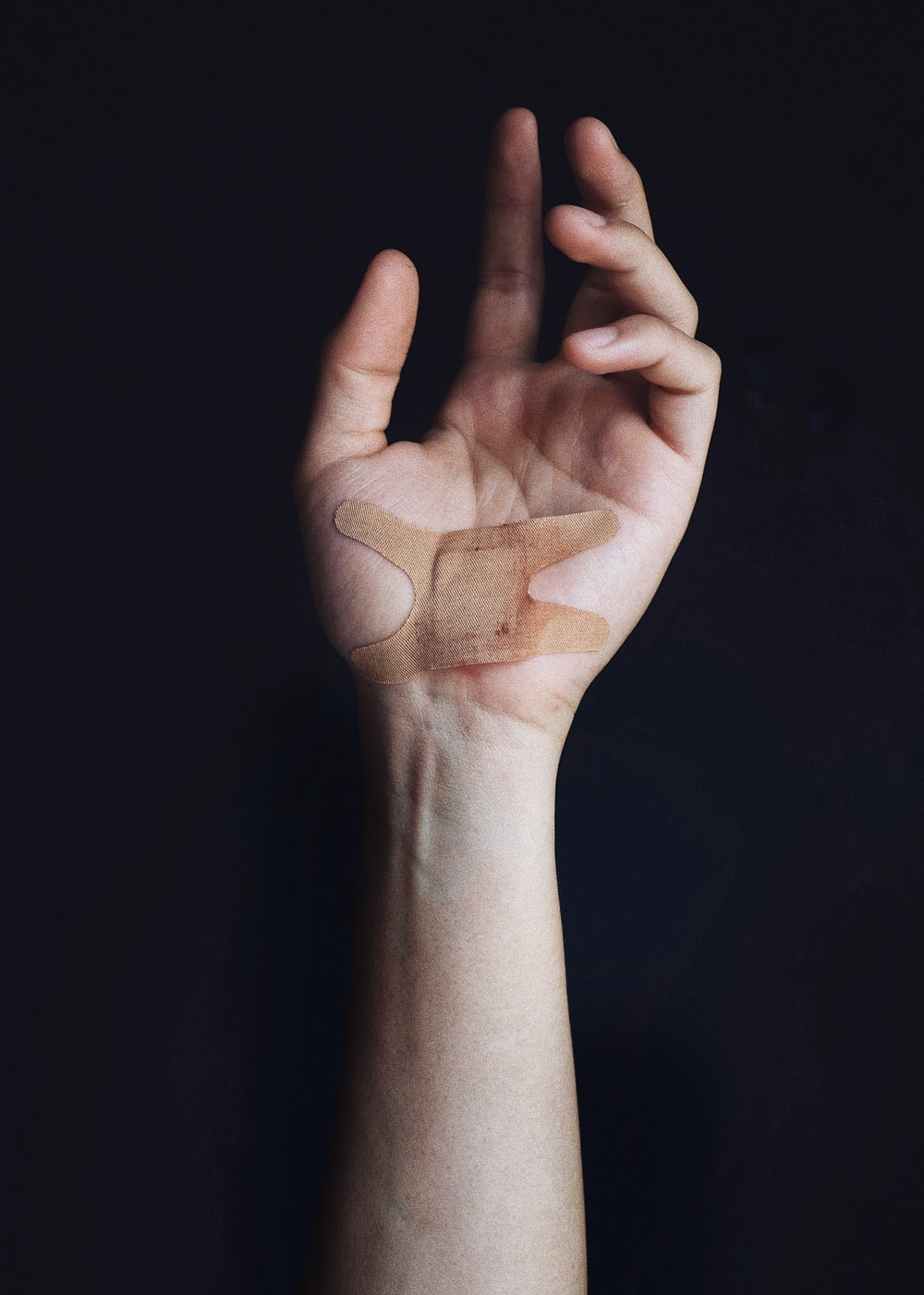 person's left palm with bandage