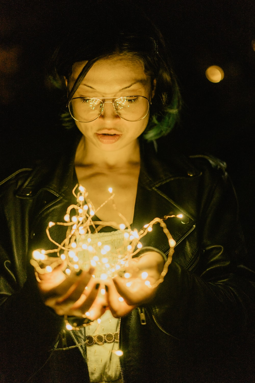 woman holding string light