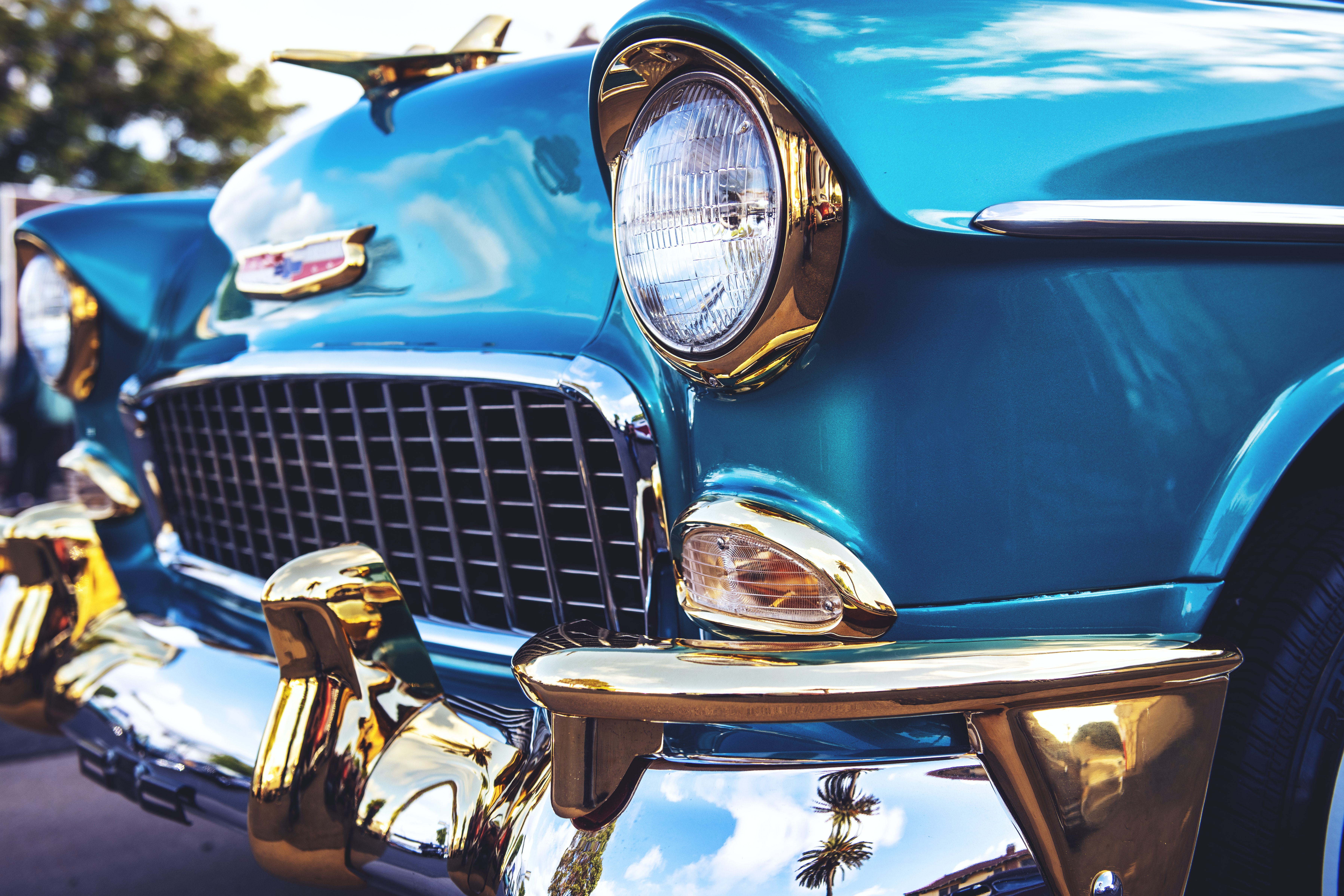 selective focus photography of blue Chevrolet Bel Air