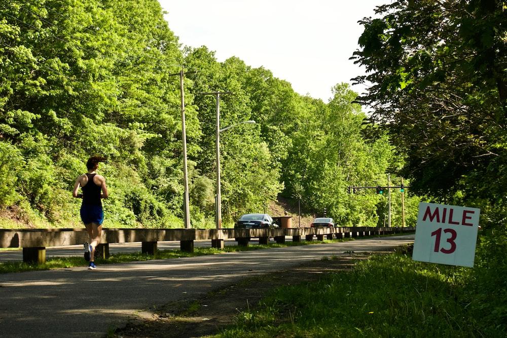 person running near road