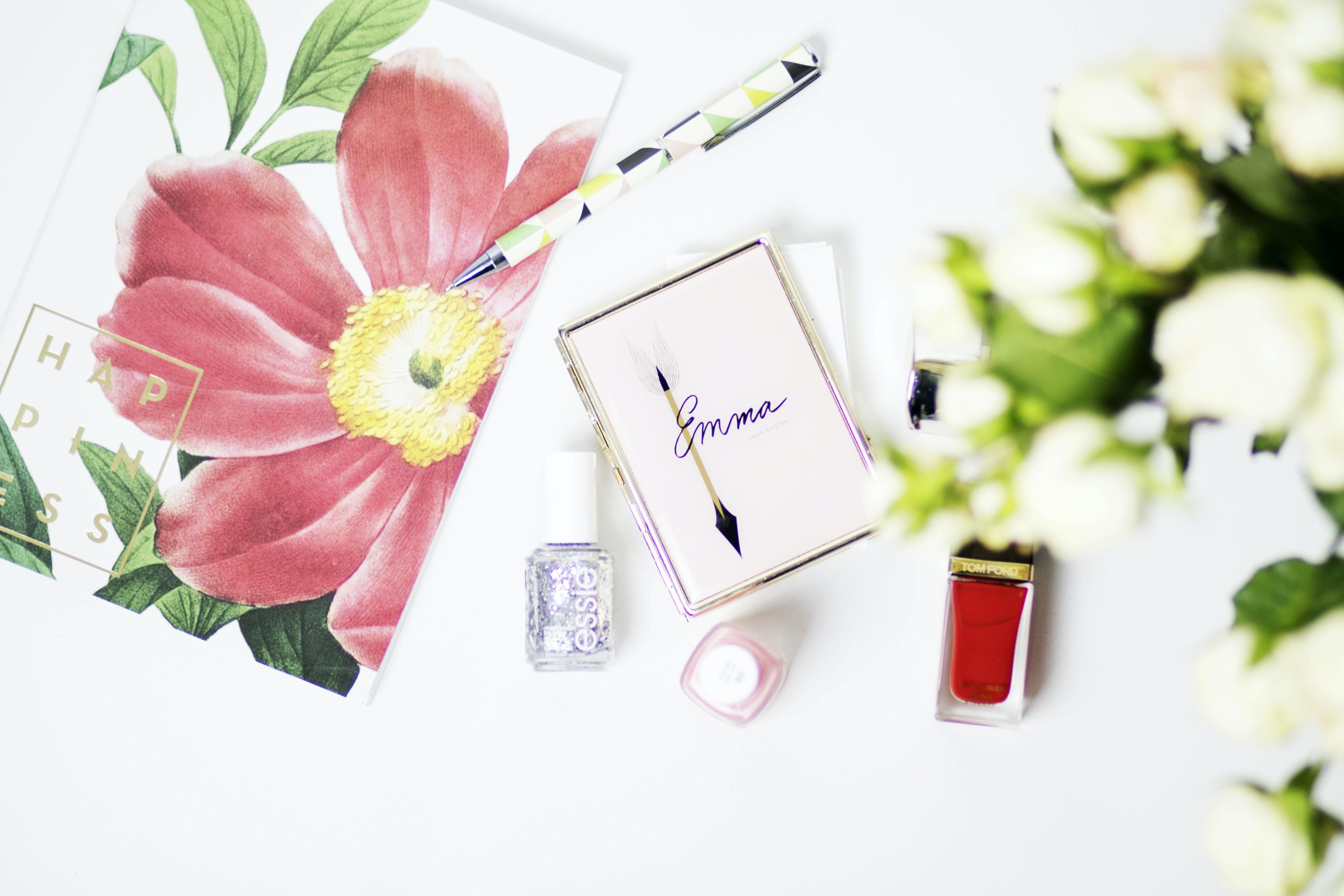 pink Emma box beside nail polish