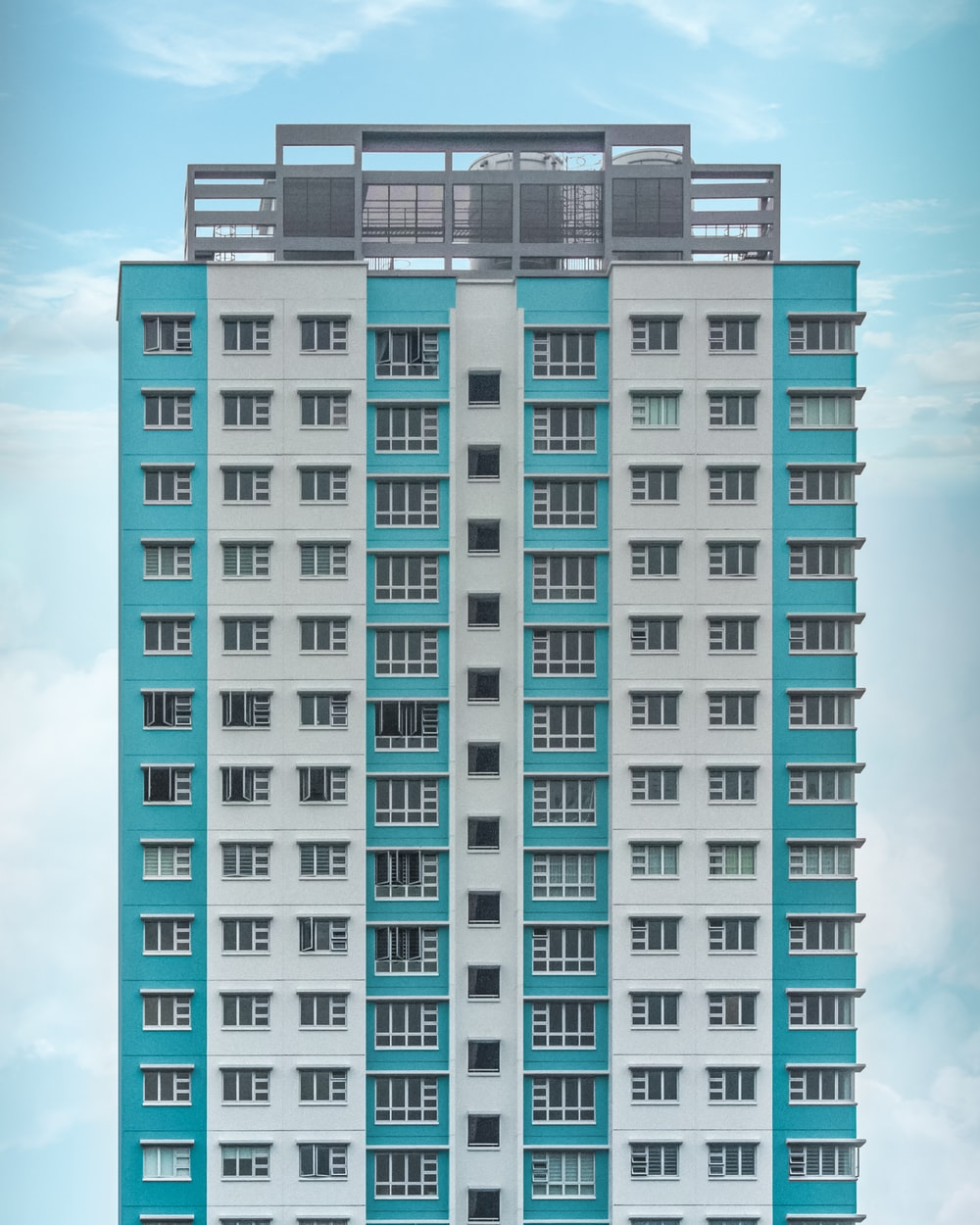 teal and white high-rise building