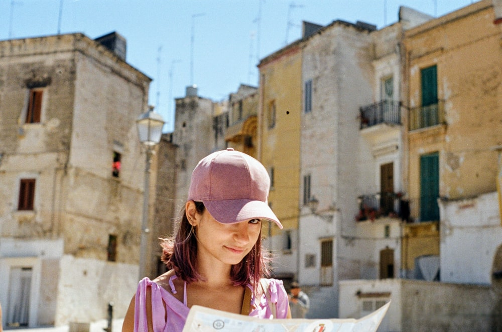 woman wearing pink fitted cap in city