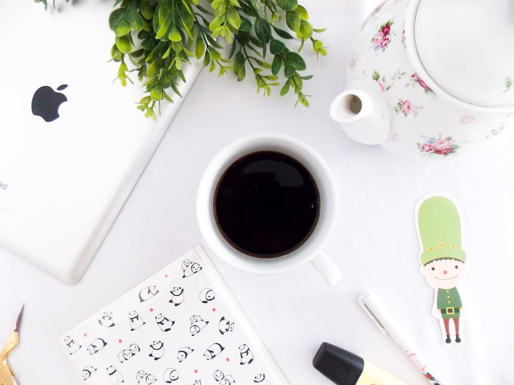 flat lay photography of coffee mug and ipad