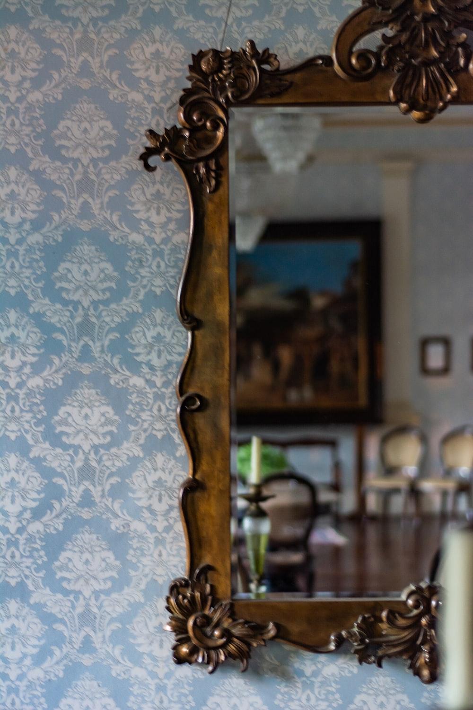rectangular brown framed mirror