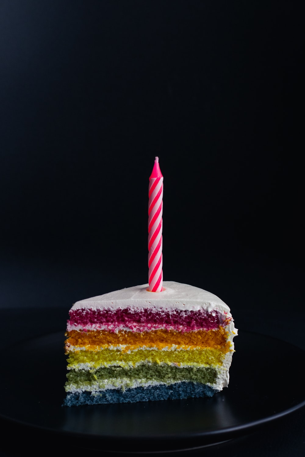 slice of cake with candle on top