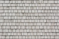 closeup photo of gray roof shingles