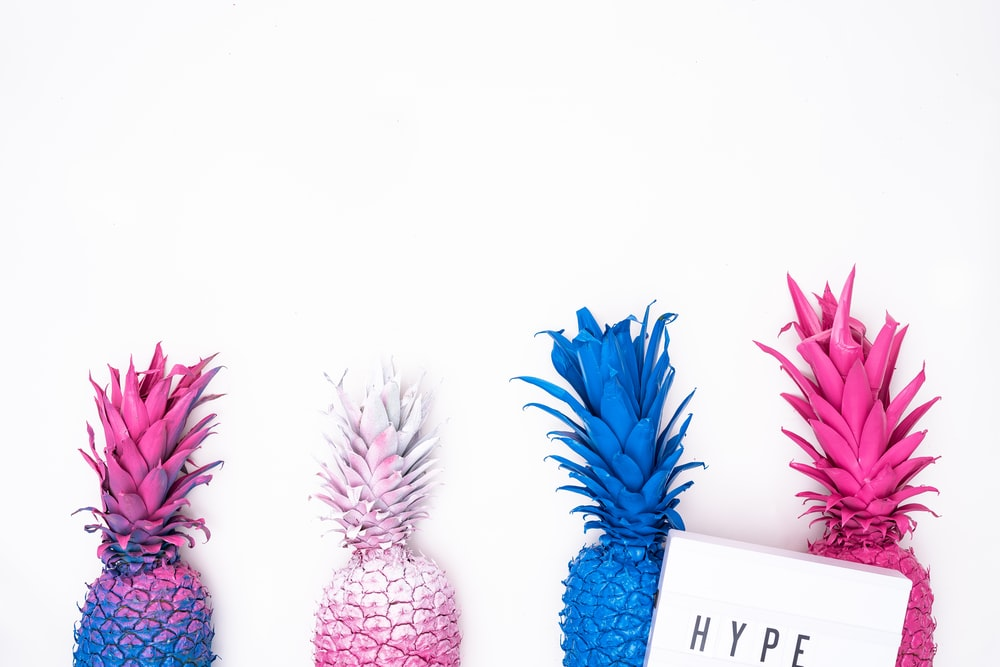 four assorted-color pineapple illustration