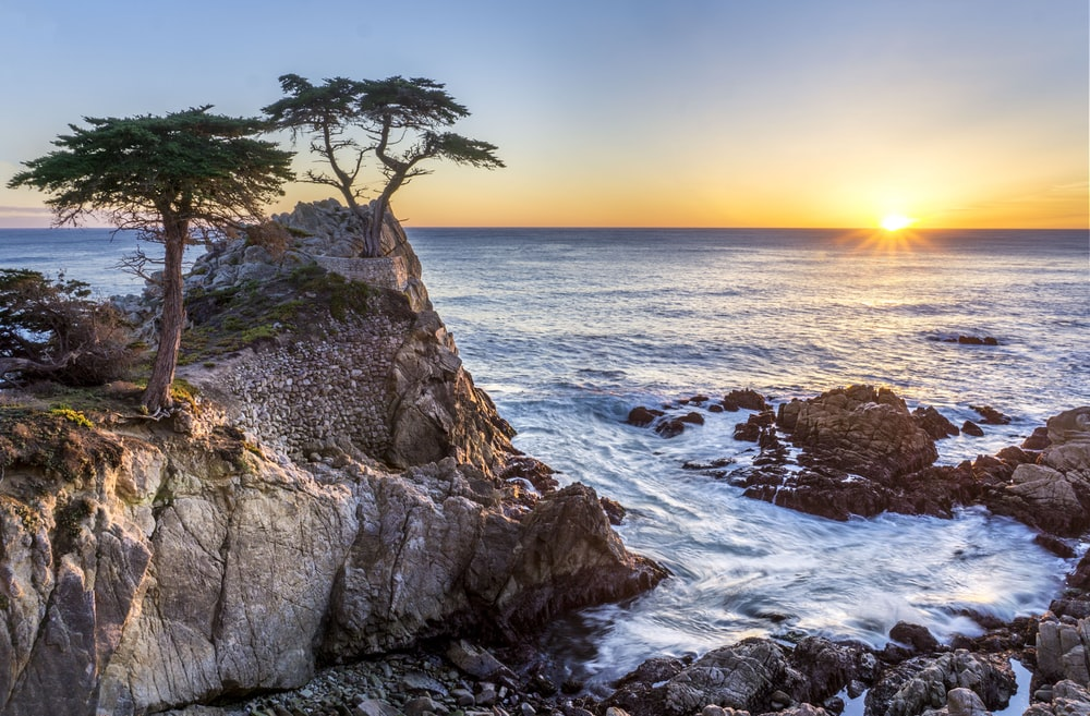 sea waves on rock formation during sunrise