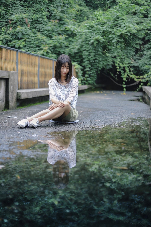 woman sitting gray surface