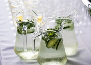 clear glass pitcher with content