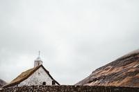 white concrete church under cloudy sky