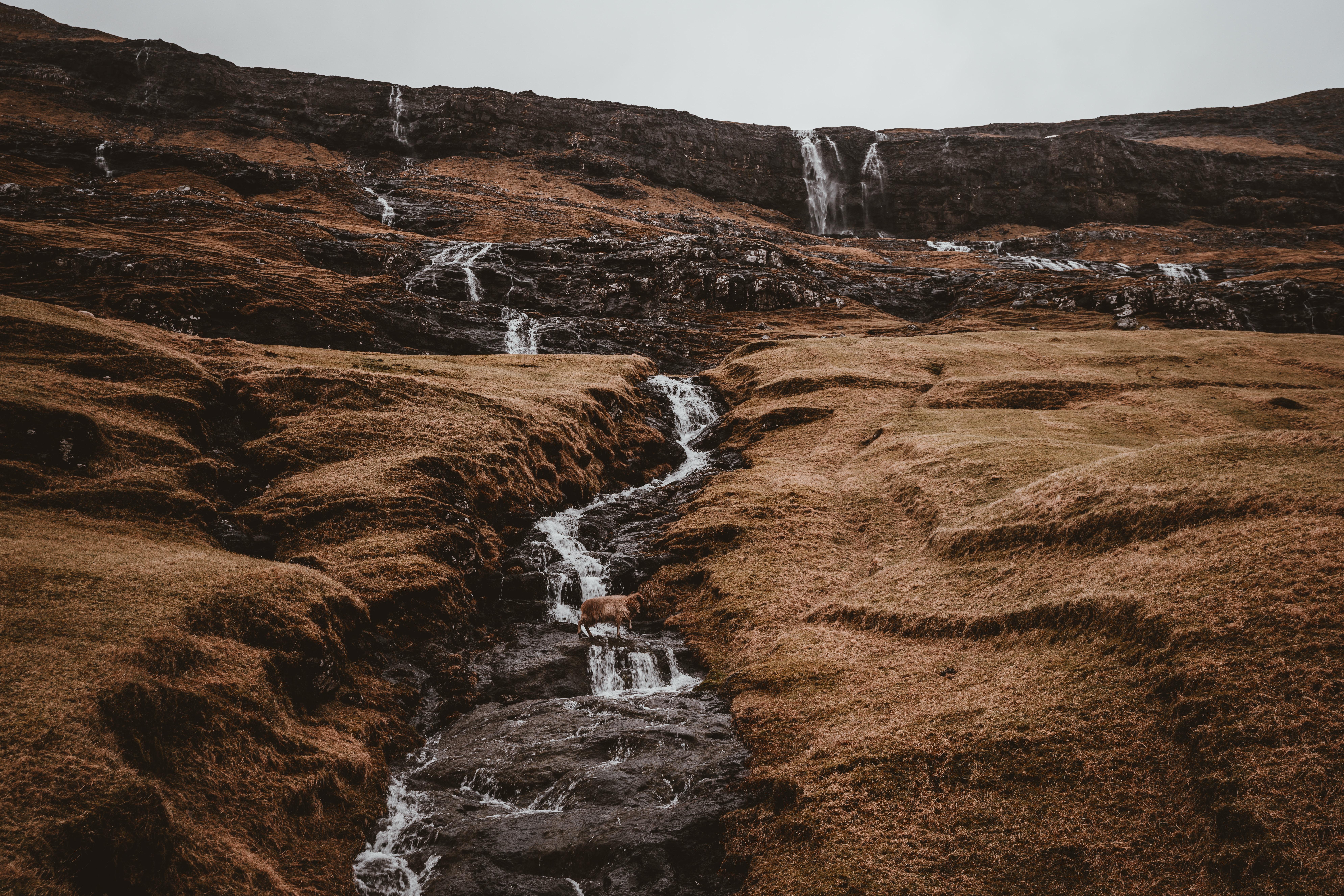 waterfalls under clear sky