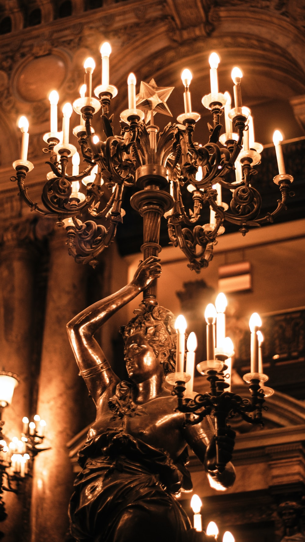 woman holding candelabra statue