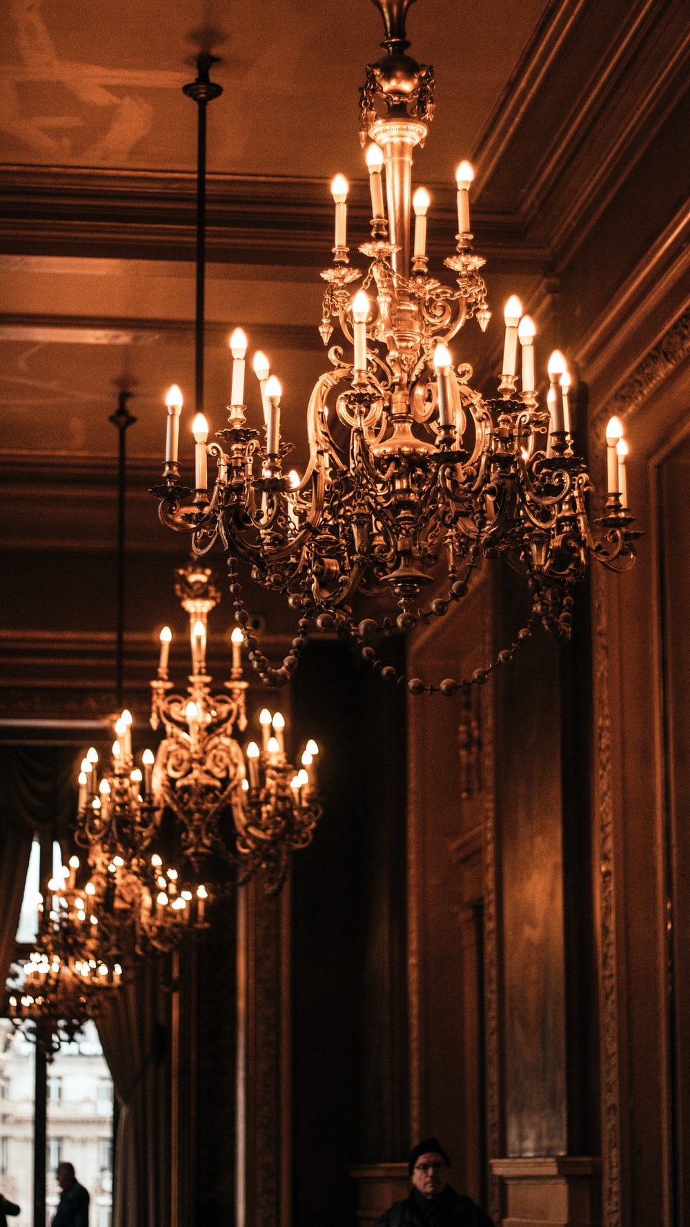 lighted brown and black uplight chandelier
