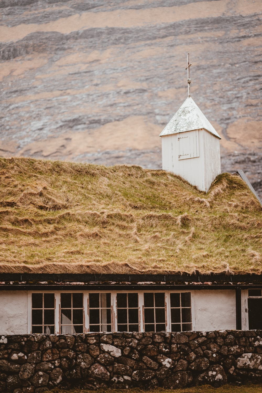 white chapel near the mountain
