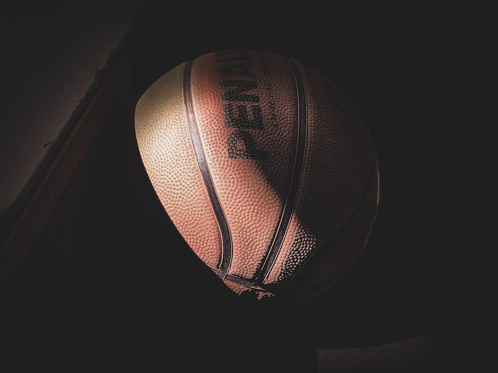 basketball near brown table