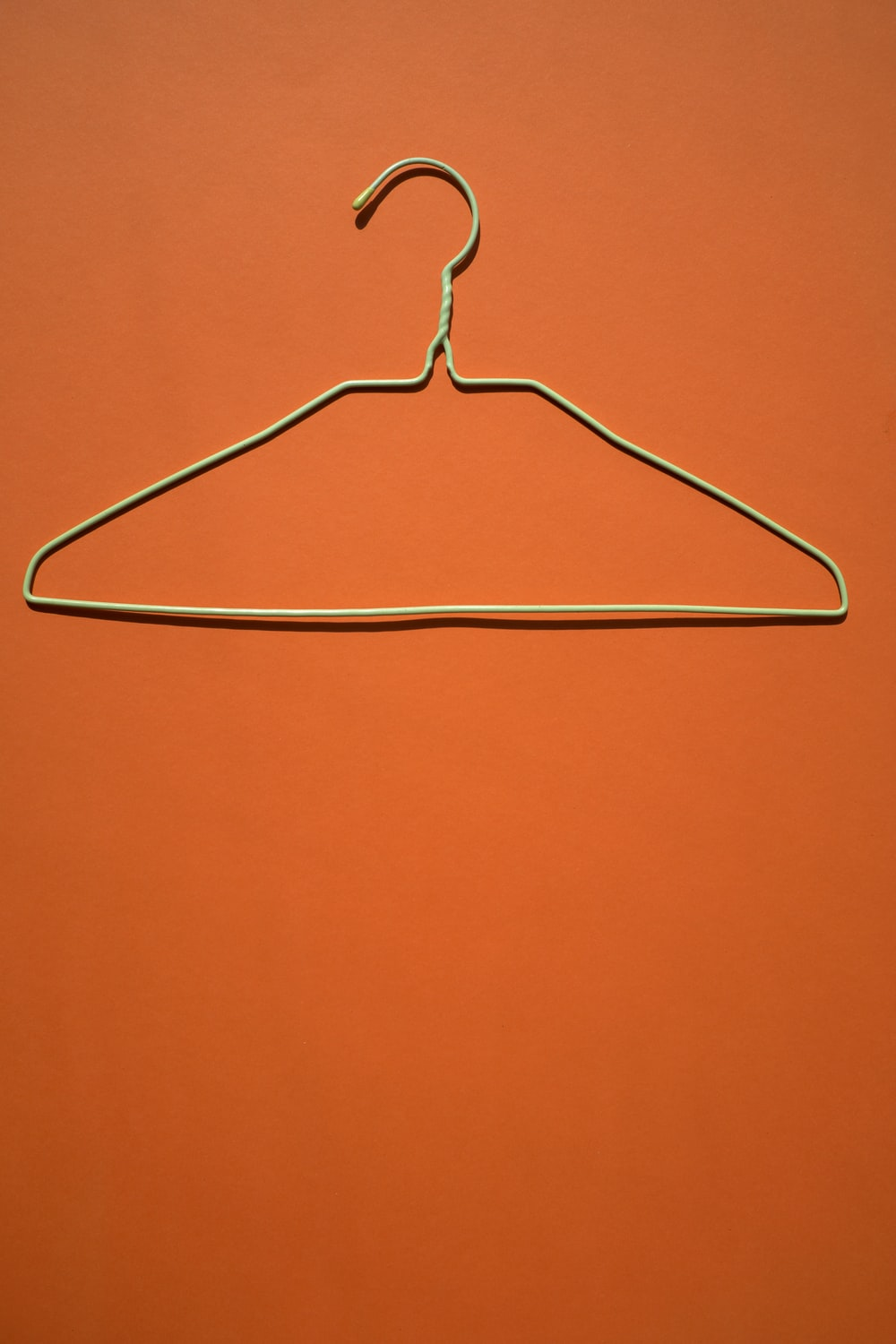 white clothes hanger on orange flooring