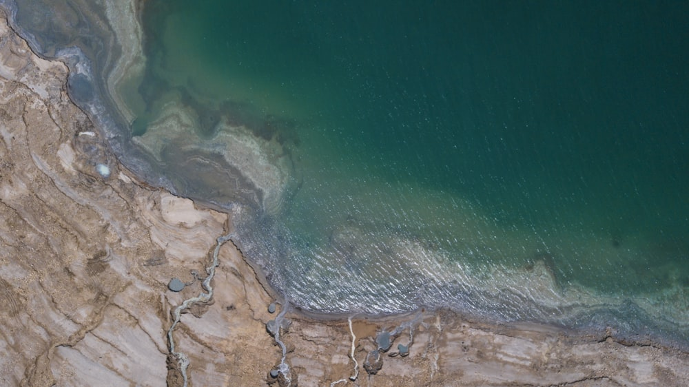 aerial view of body of water near mountain