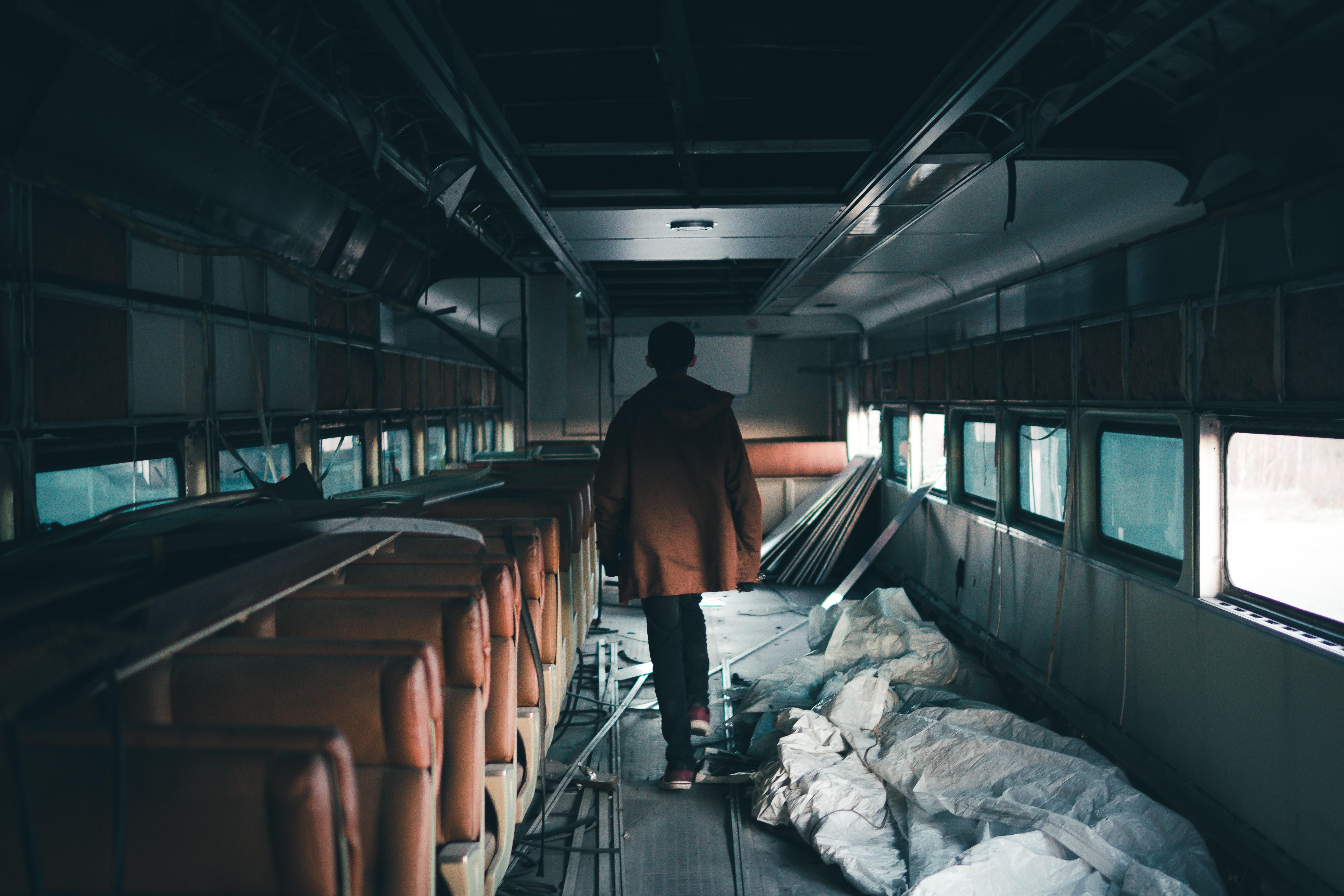 person walking inside train
