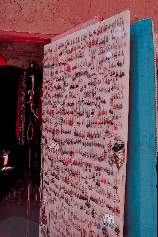 assorted earrings on white board