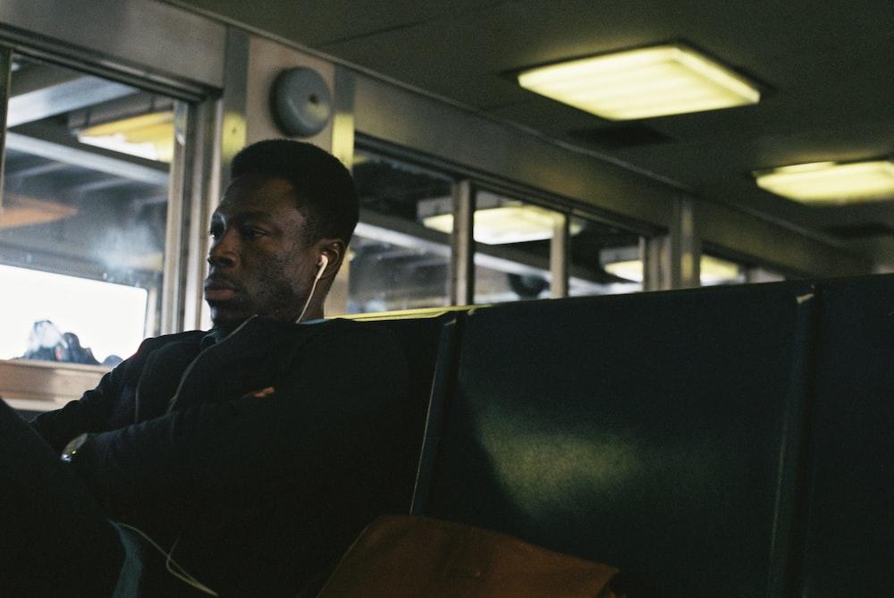 man wearing white earphones
