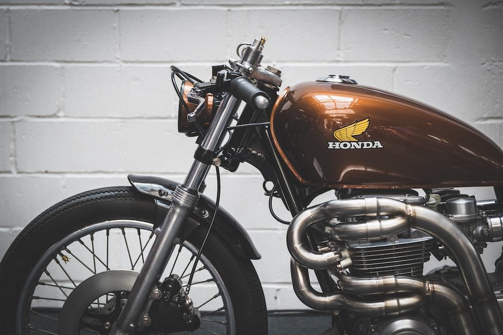 brown Honda standard motorcycle