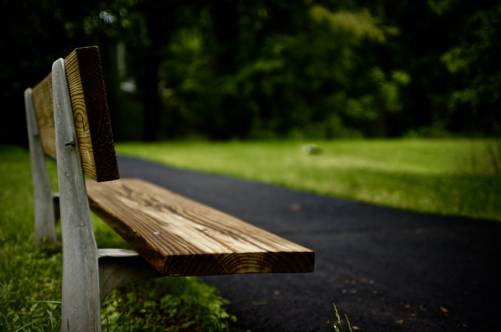 rule of thirds photography of brown bench