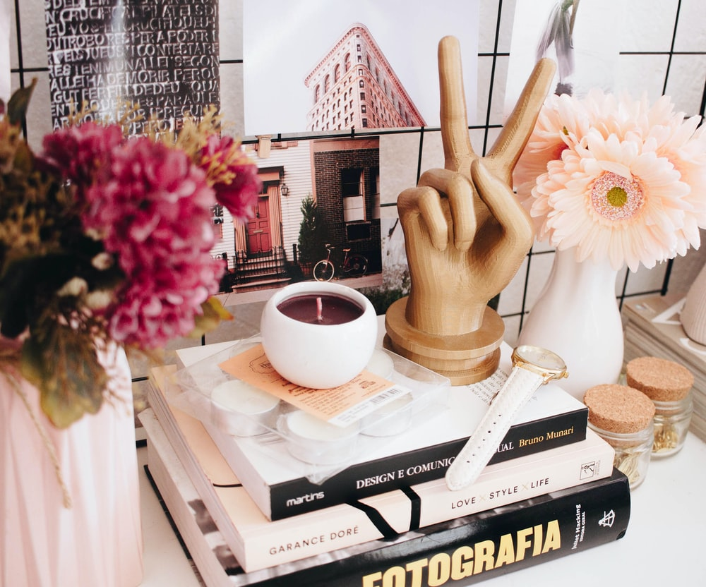 three assorted books